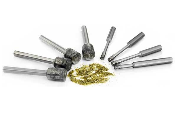 Diamond grinding drill bits